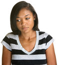 Serious teen looking down african female teenager on isolated background Royalty Free Stock Images