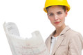 Serious woman architect with yellow helmet looking at the camera Royalty Free Stock Photo