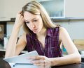 Serious woman with documents in kitchen Royalty Free Stock Photo