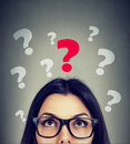 Serious woman looking up at key question Royalty Free Stock Photo