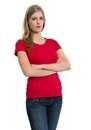Serious woman posing with red shirt young beautiful sexy female blank and look on her face ready for your design or artwork Stock Photo