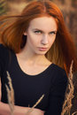 Serious woman with red hair portrait Stock Images