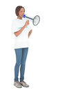 Serious woman shouting in megaphone on white background Stock Images