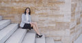 Serious woman sitting on stairs outdoors Royalty Free Stock Photo