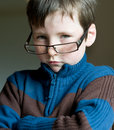 Serious young boy with glasses like businessman Royalty Free Stock Photo