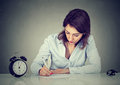 Serious young business woman writing a letter or filling out an application form Royalty Free Stock Photo