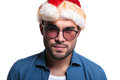 Serious young casual man in santa hat closeup picture of a looking at the camera Stock Photography