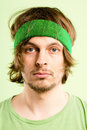 Serious young man wearing head band portrait Royalty Free Stock Photos