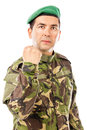 Serious young soldier with arm raised showing his fist isolated on white background Royalty Free Stock Photos