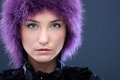 Serious young woman in purple wig Royalty Free Stock Photos