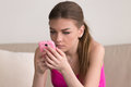 Serious young woman using cellphone at home Royalty Free Stock Photo
