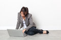 Serious young woman working on her laptop relaxing for inspiration Royalty Free Stock Photo