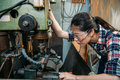 Factory woman wearing safety protection glasses Royalty Free Stock Photo