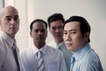 Serous vietnamese businessman with his colleagues in the background Royalty Free Stock Images