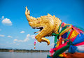Serpent the golden head or king of naga statue on blue sky background is located on the banks of mekong river in thailand Royalty Free Stock Photography