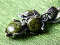 Serpentine earring silver with green stones Stock Image