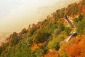 Serpentine road many curves of mountain in montenegro with kotor old town on background Stock Photos