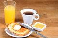 Served breakfast: coffee, toasts with butter, jam and orange juice Royalty Free Stock Photo