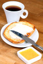 Served breakfast: cup of coffee, toasts with butter and jam Royalty Free Stock Photo