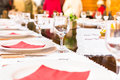 Served dinner table with red napkin in a restaurant. Defocused background Royalty Free Stock Photo