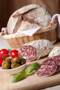 Served kitchen table salami, breadbasket, s Stock Photo