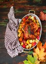 Served roasted Thanksgiving Turkey with vegetables on wooden background Royalty Free Stock Photo