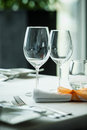 Served table with wine glasses in a restaurant Stock Images