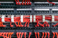 Server rack with red cables Royalty Free Stock Photo
