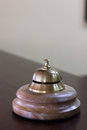 Service bell in a hotel reception for concierge alarm on desk. Royalty Free Stock Photo