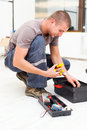 Service man with his toolbox at work using tools from Royalty Free Stock Photos