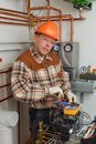 Service man working furnace cellar Royalty Free Stock Image