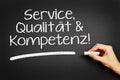 Service qualität kompetenz service quality competence hand writes in german on blackboard Stock Image
