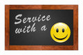Service with a smile written chalk on wooden frame blackboard Stock Photography