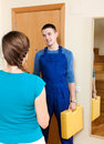 Service worker came to call girl meeting at the door Stock Images