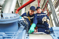 Service workers at industrial compressor station Royalty Free Stock Photo