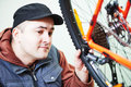 Serviceman installing assembling or adjusting bicycle gear on wh Royalty Free Stock Photo