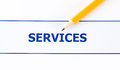 Services text and pencil closeup Stock Images