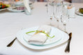 Serviette on a plate served on festive table the Royalty Free Stock Photos