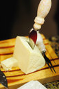 Serving cheese chunk of sharp white with a knife ready to be served Stock Photography