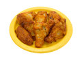 Serving of chicken wings on a yellow paper plate Royalty Free Stock Photo