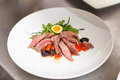 Serving of delicious medium rare sliced steak Royalty Free Stock Photo
