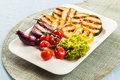 Serving of delicious roasted and fresh vegetables Royalty Free Stock Photo