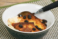 Serving home made bread butter pudding bowl Stock Photo