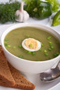 Serving of spinach cream soup with vegetables Royalty Free Stock Photo
