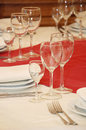 Serving of table with glasses and plates Stock Photos