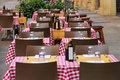 Serving tables in the Italian outdoor restaurant. Royalty Free Stock Photo