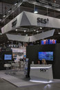 Ses global satellite services provider booth presenters work at at kyiv international exhibition and conference in broadcast Royalty Free Stock Image
