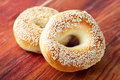 Sesame bagels on wood two the wooden surface Royalty Free Stock Images