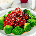 Sesame chicken also called chinese sesame seed chicken with the white rice and chopsticks Royalty Free Stock Photography