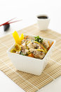 Sesame chicken noodle salad a with chopsticks and soy sauce Royalty Free Stock Image